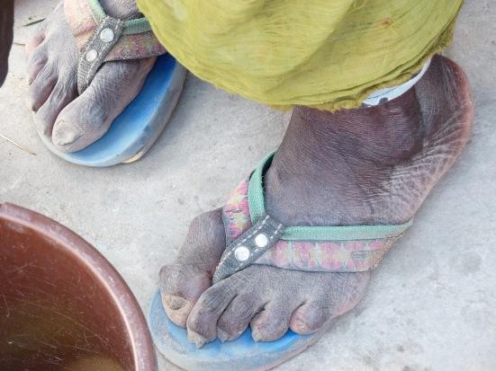 Les pieds d'une marchande